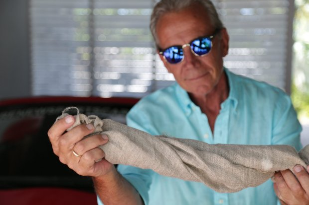 *** EXCLUSIVE - VIDEO AVAILABLE *** KEY WEST, FLORIDA - MAY 2: Bruce Dietzen with hemp cloth on May 02 2016 in Key West, Florida. A SPORTS car made from cannabis hemp could lead the charge in making carbon neutral vehicles. Made from the chassis of a Mazda convertible, the hemp car is bringing a new meaning to the phrase ëgreen machineí and could soon be seen on high roads around the world. The man behind the car, Bruce Dietzen from Florida, hopes his environmentally friendly automobile could help debunk the taboo behind the cannabis plant and its uses. Bruce was inspired to build the sports car after hearing about renowned industrialist, Henry Ford, using the durable material in 1941 to build the worldís first hemp car. PHOTOGRAPH BY Quincy Perkins / Barcroft Cars London-T:+44 207 033 1031 E:hello@barcroftmedia.com - New York-T:+1 212 796 2458 E:hello@barcroftusa.com - New Delhi-T:+91 11 4053 2429 E:hello@barcroftindia.com www.barcroftimages.com